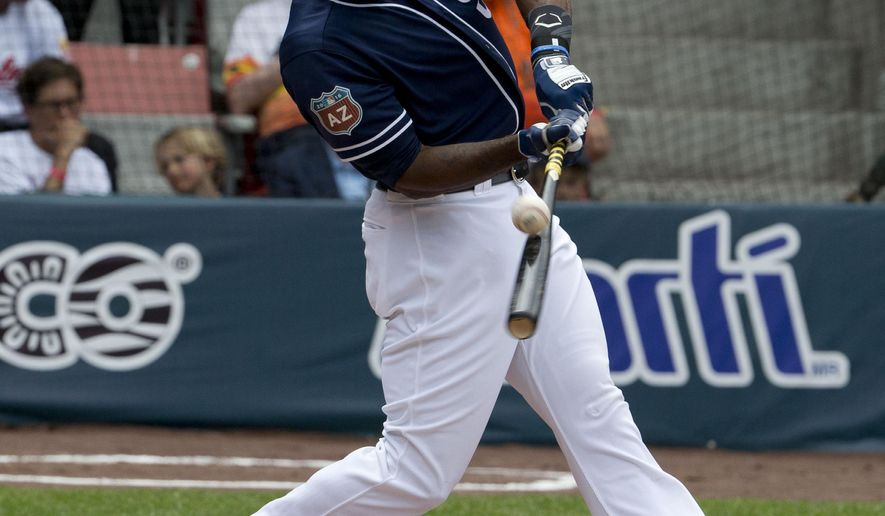 San Diego Padres' outfielder Jabari Blash hits the ball as he bats during a spring training baseball game with the Houston Astros in Mexico City, Sunday, March 27, 2016. (AP Photo/Eduardo Verdugo)