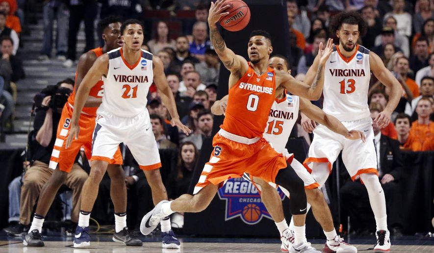 Syracuse's Michael Gbinije (0) grabs a loose ball during the first half of a college basketball game against Virginia in the regional finals of the NCAA Tournament, Sunday, March 27, 2016, in Chicago. (AP Photo/Charles Rex Arbogast)