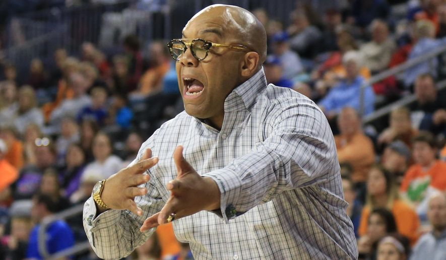 Syracuse coach Quentin Hillsman calls instructions during a women's college basketball regional final against Tennessee in the NCAA Tournament in Sioux Falls, S.D., Sunday, March 27, 2016. (AP Photo/Nati Harnik)