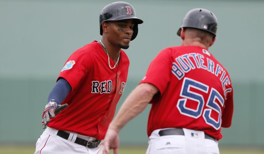 Boston Red Sox's Xander Bogaerts, left, and third base coach Brian Butterfield (55) celebrate Bogaerts solo home run off Philadelphia Phillies starting pitcher Jerad Eickhoff in the fifth inning of an interleague spring training baseball game, Sunday, March 27, 2016, in Sarasota, Fla. (AP Photo/Tony Gutierrez)