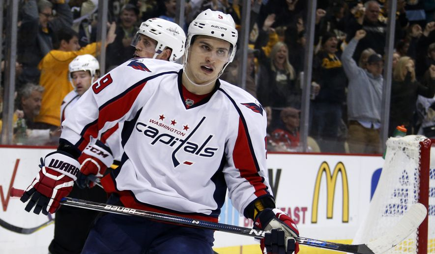 Washington Capitals defenseman Dmitry Orlov (9) plays during an NHL hockey game against the Pittsburgh Penguins in Pittsburgh, Sunday, March 20, 2016. (AP Photo/Gene J. Puskar)