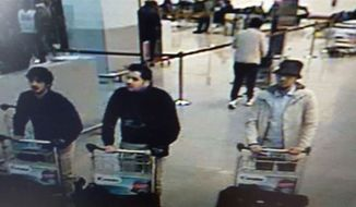 In this image provided by the Belgian Federal Police in Brussels on Tuesday, March 22, 2016, of three men who are suspected of taking part in the attacks at Belgium's Zaventem Airport. (Belgian Federal Police via AP)