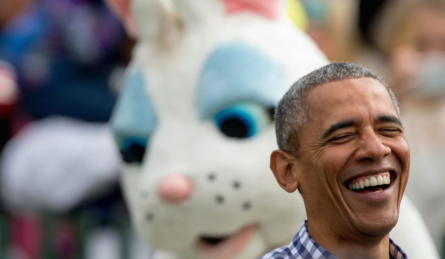 President Barack Obama, joined by the Easter Bunny, greets members of the audience on the South Lawn at the White House Easter Egg Roll at the White House in Washington, Monday, March 28, 2016. Thousands of children gathered at the White House for the annual Easter Egg Roll which features live music, sports courts, cooking stations, storytelling, and Easter egg rolling. (AP Photo/Andrew Harnik)