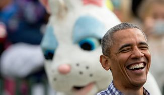President Barack Obama, joined by the Easter Bunny, greets members of the audience on the South Lawn at the White House Easter Egg Roll at the White House in Washington, Monday, March 28, 2016. Thousands of children gathered at the White House for the annual Easter Egg Roll which featureslive music, sports courts, cooking stations, storytelling, and Easter egg rolling. (AP Photo/Andrew Harnik)