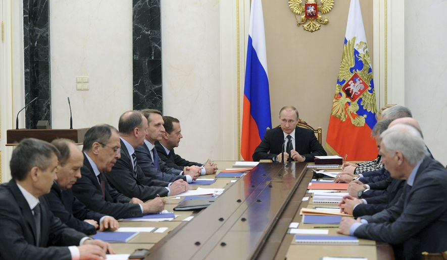 Russian President Vladimir Putin, center, leads the meeting of the State Council in the Kremlin in Moscow, Russia, Monday, March 28, 2016. (Mikhail Klimentyev, Sputnik, Kremlin Pool Photo via AP)