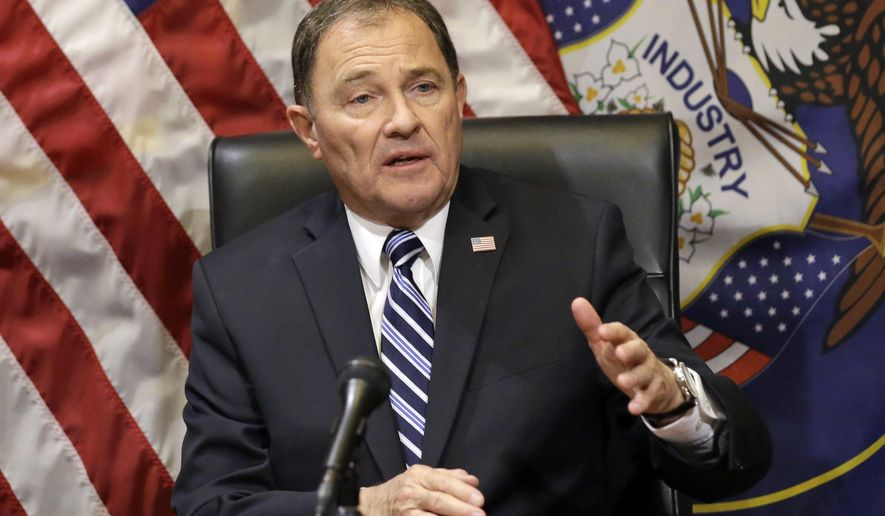 FILE - In this Feb. 17, 2016 file photo, Utah Gov. Gary Herbert speaks with reporters during a news conference at the Utah State Capitol, in Salt Lake City. The governor signed a bill Monday, March 28, 2016, that makes Utah the first state to require doctors to give anesthesia to women having an abortion at 20 weeks of pregnancy or later. The bill signed by Republican Gov. Herbert is based on the disputed premise that a fetus can feel pain at that point. (AP Photo/Rick Bowmer, File)