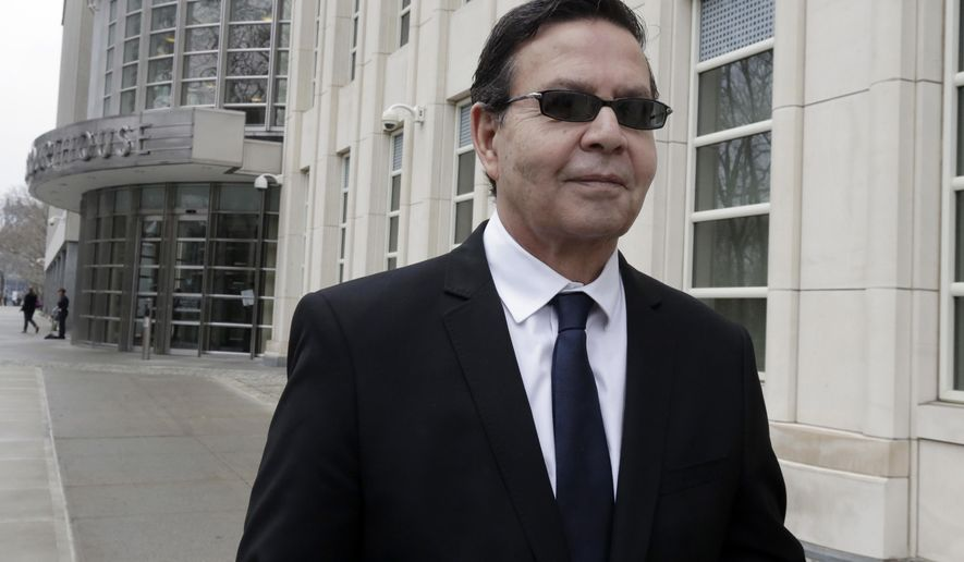 Former Honduran President Rafael Callejas leaves federal court in New York, Monday, March 28, 2016. Calleja has pleaded guilty to conspiracy charges in a wide-ranging FIFA soccer scandal. Callejas, a member of FIFA's television and marketing committee, entered the plea Monday in federal court in Brooklyn. (AP Photo/Richard Drew)