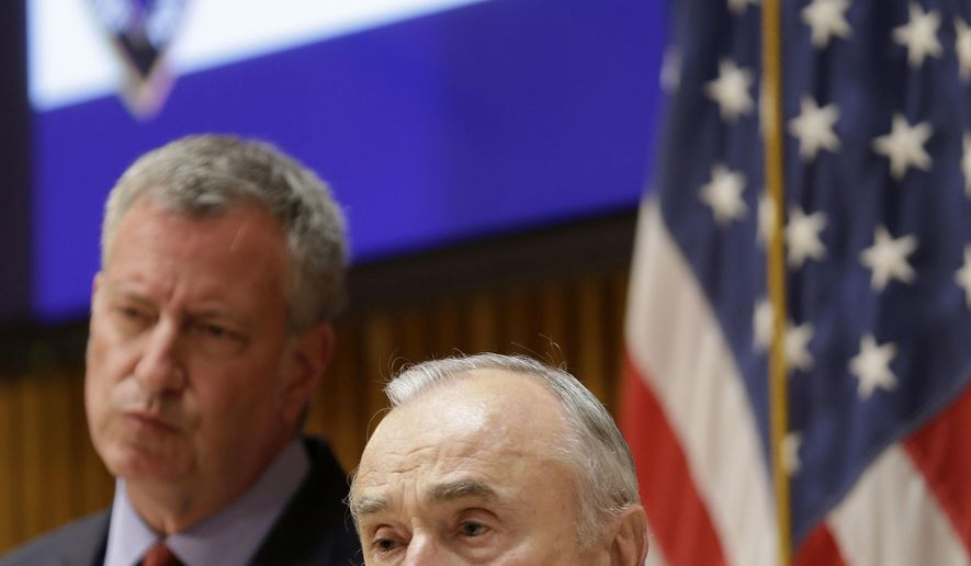 While New York City Mayor Bill de Blasio, left, listens, Police Commissioner Bill Bratton speaks during a news conference in New York, Monday, March 28, 2016. Bratton and de Blasio were speaking about an active shooter exercise that they participated in at police headquarters.  The New York Police Department practiced how officials and officers would respond to a Brussels-style attack. (AP Photo/Seth Wenig, Pool)