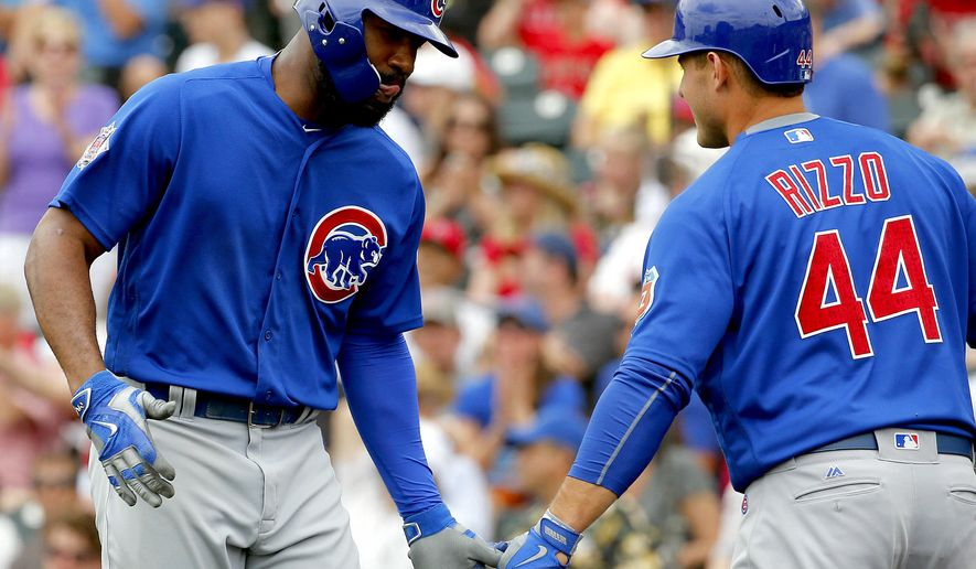 Chicago Cubs' Jason Heyward greets teammate Anthony Rizzo after hitting a three-run home run against the Los Angeles Angels during the third inning of a spring training baseball game, Monday, March 28, 2016, in Tempe, Ariz. Rizzo hit a solo home run during his at-bat. (AP Photo/Matt York)