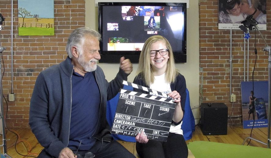 "Jonathan Goldsmith, left, works on a public service announcement with Jamie Heath of Barre, Vt., Monday, March 28, 2016, at the Make-A-Wish Vermont office in Burlington, Vt. Goldsmith, who appeared for nine years as the ""Most Interesting Man in the World,"" in Dos Equis beer commercials, will star in public service announcements for Make-a-Wish Foundation Vermont. The Mexican beer brand recently dropped the 77-year-old for a younger replacement, who will appear in commercials later this year. (AP Photo/Lisa Rathke)"