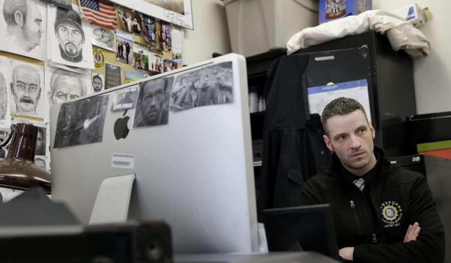 In this Wednesday, March 23, 2016 photo, police officer Matthew Klein talks to a reporter at his desk in the NYPD Artist Unit in New York. (AP Photo/Seth Wenig)