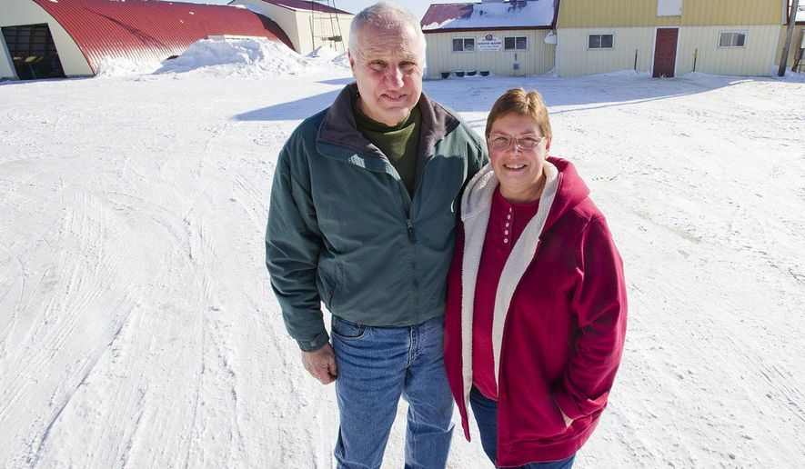 In this Feb. 5, 2015 photo, Art Thicke and his wife, Jean, pose for a photo in La Crescent, Minn. They are among the many area farmers nearing retirement who have to consider options for transitioning their farm. A new program by the Minnesota Department of Agriculture seeks to build connections between farmers who are ready to get out of the business and those who want to get in. (Andrew Link/The Winona Daily News via AP) MANDATORY CREDIT