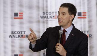 In this Sept. 10, 2015 file photo, Wisconsin Gov. Scott Walker speaks in Eureka, Ill. (AP Photo/Seth Perlman, File)