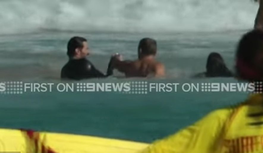 Australian actor Hugh Jackman sprang into action Saturday when several swimmers got caught in a riptide at Sydney's Bondi Beach. (Nine News screengrab)