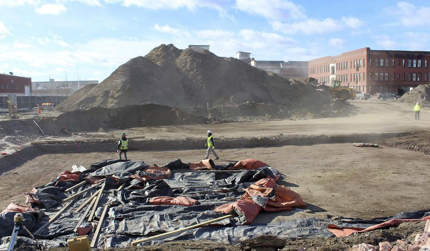 In this Jan. 19, 2016 photo, workers clear the site where a planned MGM casino is to be built in Springfield, Mass. The project endured a lengthy review by historic preservation authorities over the planned demolition of downtown buildings in the months after the March 24, 2015 groundbreaking. The casino is now slated to open September 2018, a year behind initial projections. (Dan Glaun/MassLive.com via AP)