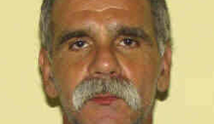 This undated photo shows provided by the Ohio Department of Rehabilitation and Corrections shows John Modie. The Ohio Department of Rehabilitation and Correction on Monday, March 28, 2016, confirmed the possible escape of Modie, convicted of killing a woman in Cleveland, from the Hocking Unit of the Southeastern Correctional Complex in Nelsonville. The department says Modie was found to be missing during the 11:00 p.m. count of inmates Sunday night. (Ohio Department of Rehabilitation and Corrections via AP)