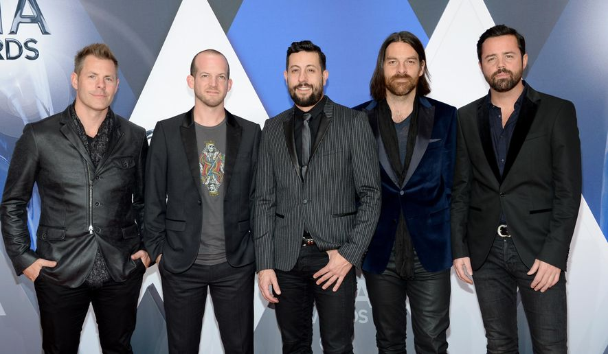 FILE - In this Nov. 4, 2015, file photo, members of Old Dominion, from left, Trevor Rosen, Whit Sellers, Matthew Ramsey, Geoff Sprung and Brad Tursi arrive at the 49th annual CMA Awards at in Nashville, Tenn. When members of the band saw their name on the voting ballots for the 51st Academy of Country Music Awards that will be held Sunday, April 3, 2016, for both new vocal duo/group of the year and vocal group of the year, the whole thing felt like a joke on them. (Photo by Evan Agostini/Invision/AP, File)