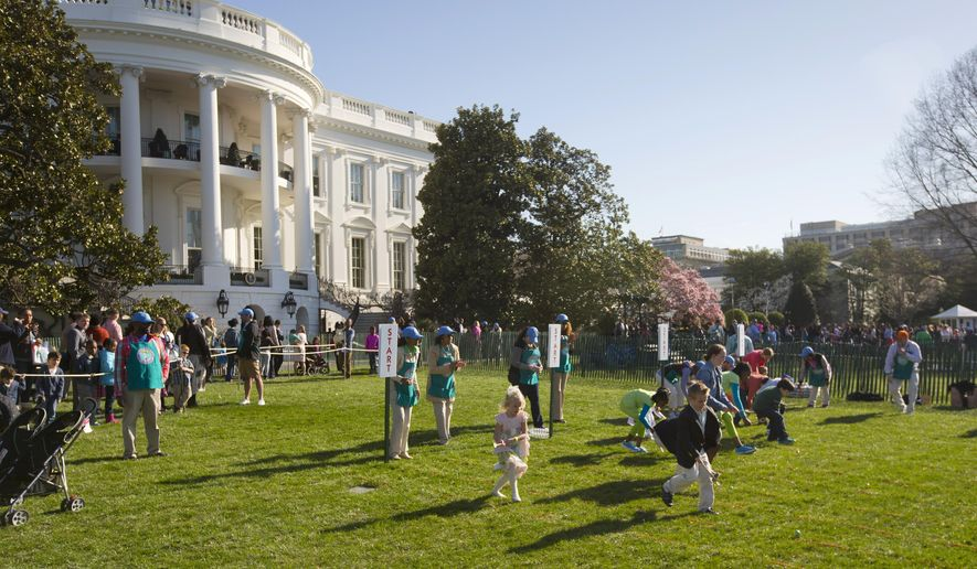 FILE - In this April 6, 2015, file photo, children participate in the White House Easter Egg Roll on the South Lawn of White House in Washington. Thousands of children will descend upon the White House on Monday, March 28, 2016, for the annual Easter Egg Roll. (AP Photo/Pablo Martinez Monsivais, File)