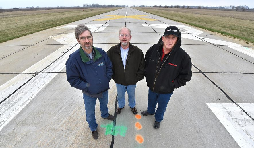 Onawa Racing and Events Complex officers from left, President Brett Ewing, secretary Bill Wonder and vice-president Phil Schroeder stand where the starting tree will be located Wednesday, March 23, 2016, at the site of the former Onawa airport in Onawa, Iowa. The group plans drag racing on the former airport's runway. Sioux City Journal photo by Tim Hynds
