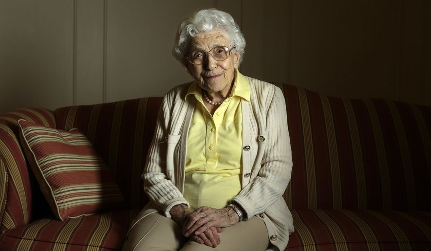 In this Wednesday, March 16, 2016 photo, 104-year-old Elsa Zopfi, originally of Switzerland, sits for a portrait at Laurelmead Cooperative retirement community, in Providence, R.I. The wealthy retirement community has six centenarians. (AP Photo/Steven Senne)