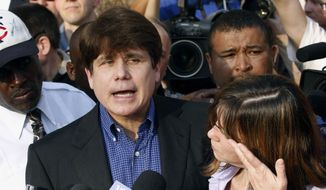 In this March 14, 2012, file photo, former Illinois Gov. Rod Blagojevich, accompanied by his wife Patti, speaks to the media outside his home in Chicago. (AP Photo/M. Spencer Green, File)