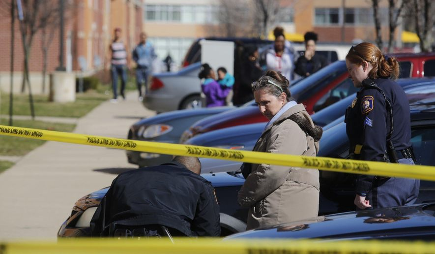 In a Friday, March 25, 2016 photo, Grand Rapids police investigate two deaths on the 100 block of Franklin St. SW in Grand Rapids, Mich. The bodies of a 60-year-old man and a 65-year-old woman were found Friday. Grand Rapids police say both victims had been shot. A gun was found at the scene. The deaths are under investigation. (Nick Gonzales/The Grand Rapids Press via AP) ALL LOCAL TELEVISION OUT; LOCAL TELEVISION INTERNET OUT; MANDATORY CREDIT