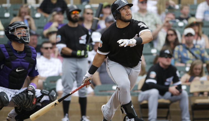 Chicago White Sox's Carlos Sanchez, right, watches the flight of his home run during the fourth inning of a spring training baseball game against the Colorado Rockies, Monday, March 28, 2016, in Scottsdale, Ariz. (AP Photo/Jae C. Hong)
