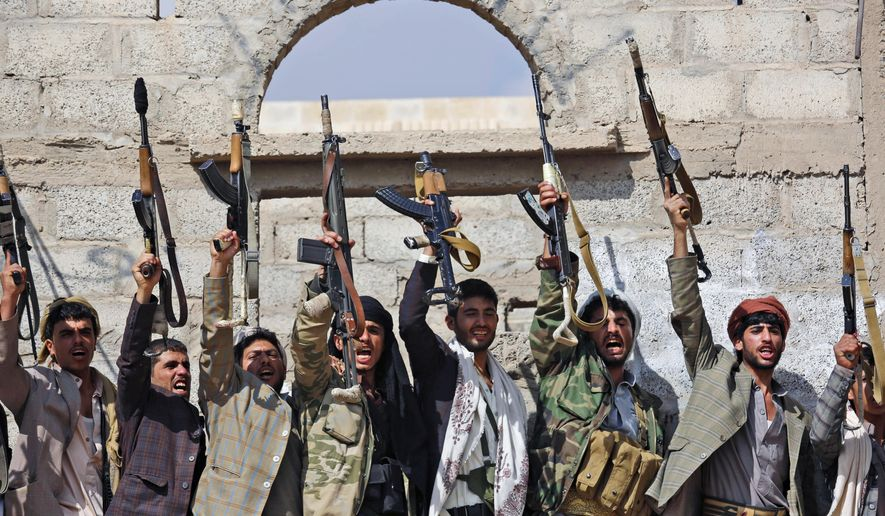 FILE - In this Dec. 15, 2015, file photo, Shiite tribesmen, known as Houthis, hold their weapons as they chant slogans during a tribal gathering showing support for the Houthi movement in Sanaa, Yemen. Saudi Arabia traded 109 Yemeni prisoners taken during its coalition war against Shiite rebels there for nine Saudis, authorities said Monday, March 27, 2016 the latest prisoner exchange ahead of a scheduled April cease-fire and peace talks. (AP Photo/Hani Mohammed, File)