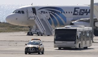 A bus carrying some passengers from the hijacked EgyptAir aircraft as at it landed at Larnaca airport Tuesday, March 29, 2016. An EgyptAir plane was hijacked on Tuesday while flying from the Egyptian Mediterranean coastal city of Alexandria to the capital, Cairo, and later landed in Cyprus where some of the women and children were allowed to get off the aircraft, according to Egyptian and Cypriot officials. (AP Photo/Petros Karadjias)