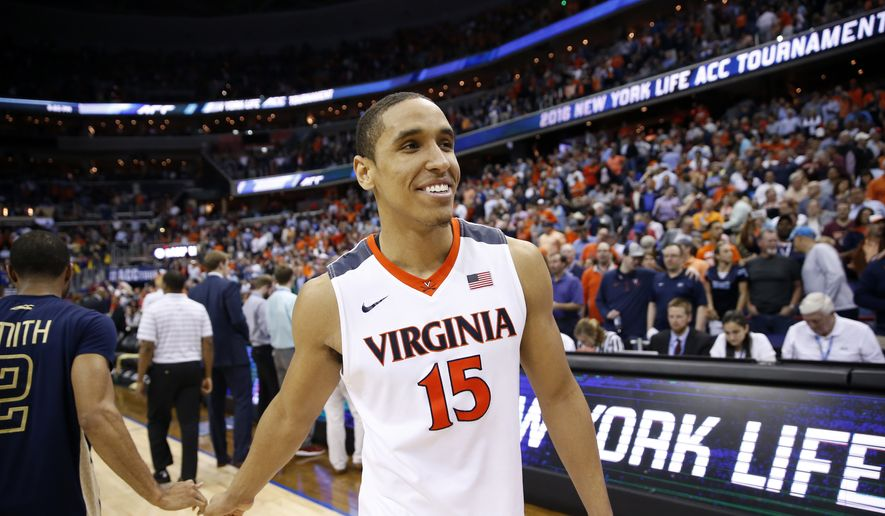 Virginia guard Malcolm Brogdon (15) smiles after an NCAA college basketball game in the Atlantic Coast Conference tournament against Georgia Tech, Thursday, March 10, 2016, in Washington. Virginia won 72-52. (AP Photo/Alex Brandon) **FILE**