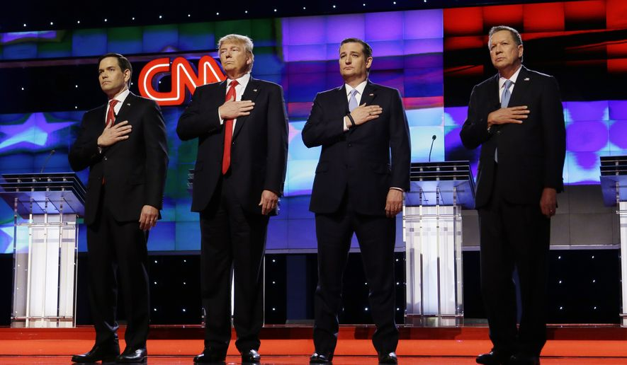 Republican presidential candidates, Sen. Marco Rubio, R-Fla., from left, Donald Trump, Sen. Ted Cruz, R-Texas, and Ohio Gov. John Kasich, stand together during the signing of the National Anthem, before the start of the Republican presidential debate sponsored by CNN, Salem Media Group and the Washington Times at the University of Miami, Thursday, March 10, 2016, in Coral Gables, Fla. (AP Photo/Wilfredo Lee)