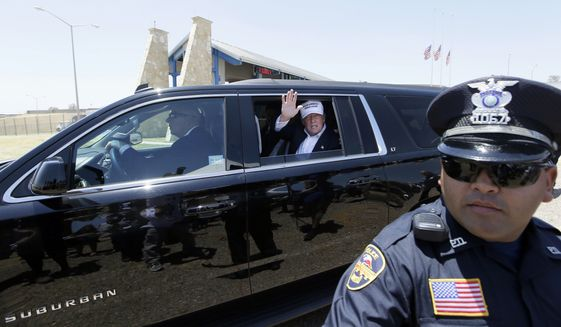 In this July 23, 2015, file photo, Republican presidential candidate Donald Trump waves from his vehicle during a tour of the the World Trade International Bridge along the U.S.-Mexico border in Laredo, Texas. (AP Photo/LM Otero, File)