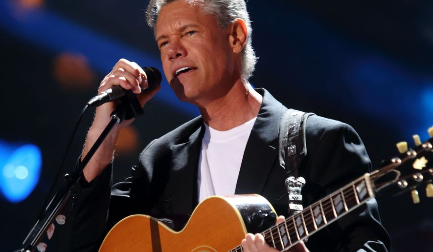 FILE - In this June 7, 2013 file photo, Randy Travis performs at the 2013 CMA Music Festival  in Nashville Tenn. The Country Music Hall of Fame along with the Country Music Association, announced Tuesday, March 29, 2016, it will induct Travis, fiddler Charlie Daniels, and producer and label owner Fred Foster into The Country Music Hall of Fame. (Photo by John Davisson/Invision/AP, File)