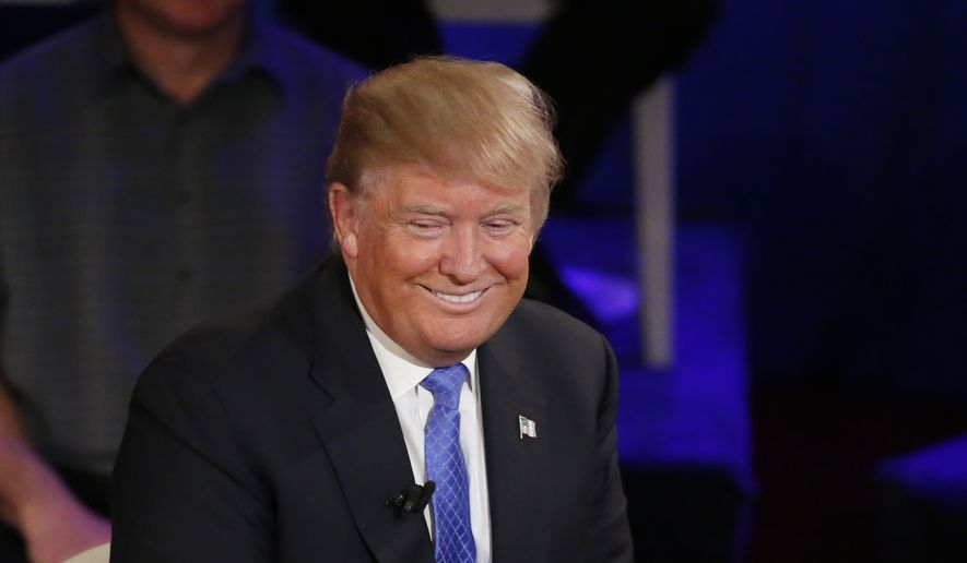 Republican presidential candidate, Donald Trump smiles during a CNN town hall with Anderson Cooper in the historic Riverside Theatre, Tuesday, March 29, 2016, in Milwaukee. (AP Photo/Charles Rex Arbogast)