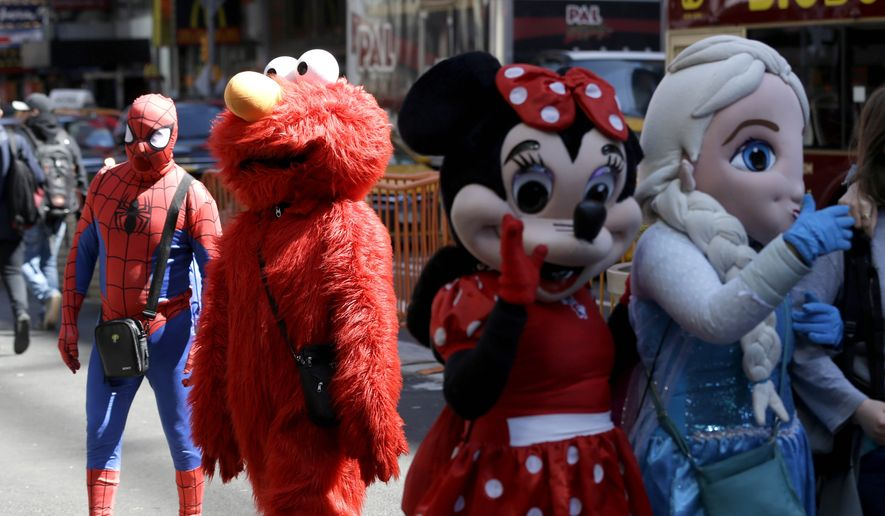 Costumed characters work for tips in Times Square in New York, Tuesday, March 29, 2016. (AP Photo/Seth Wenig) ** FILE **