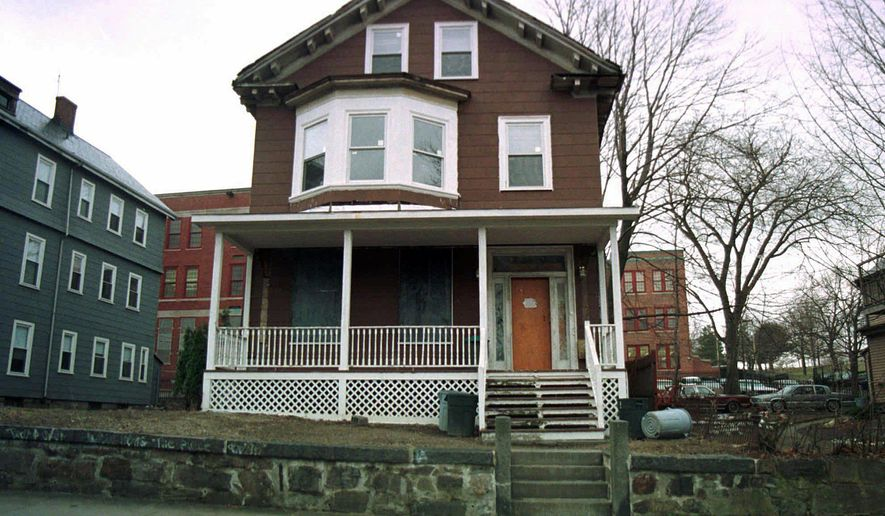This March 10, 1998, photo shows the house where slain African-American leader Malcolm X spent part of his childhood in the Roxbury section of Boston. Archeologists in Boston are digging at the boyhood home of Malcolm X. The two-week archaeological dig begins Tuesday, March 29, 2016. (AP Photo/Angela Rowlings, File)