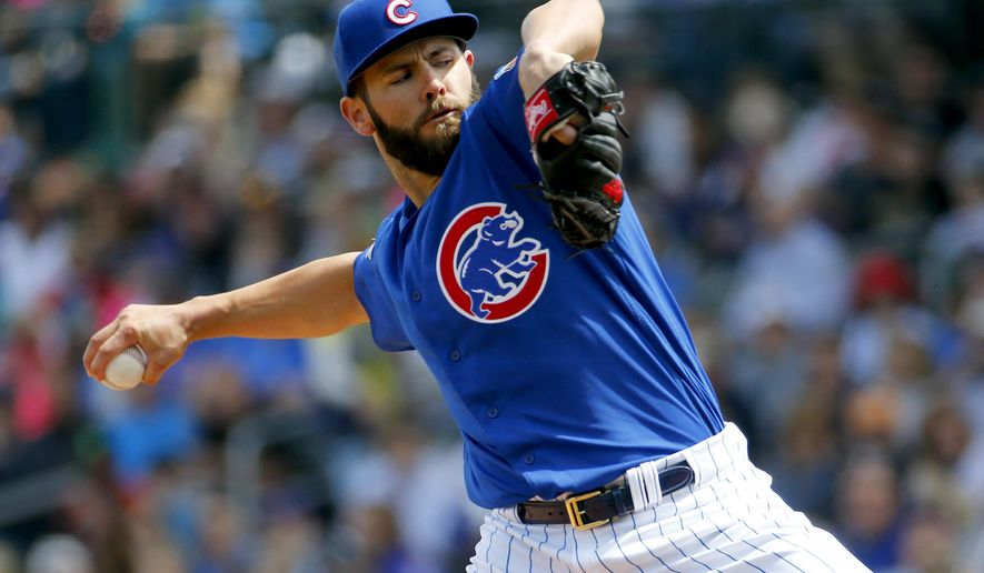 Chicago Cubs pitcher Jake Arrieta throws against the Oakland Athletics during the first inning of a spring training baseball game, Tuesday, March 29, 2016, in Mesa, Ariz. (AP Photo/Matt York)