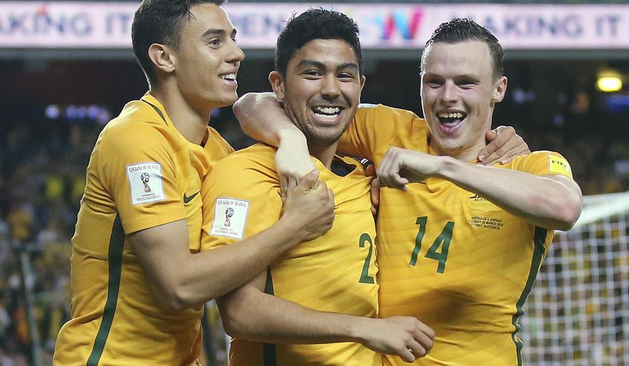 Australia's Christopher Ikonomidis, left, Massimo Luongo, center, and Brad Smith celebrate Luongo's goal during their soccer World Cup qualifying match against Jordan in Sydney, Tuesday, March 29, 2016. (AP Photo/Rick Rycroft)