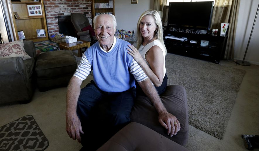 FILE - In this July 23, 2015 file photo, NFL Hall of Famer Fred Biletnikoff and his wife, Angela, pose in the living room of Tracey's Place of Hope in Loomis, Calif. The opportunity to reminisce and trade stories with old Raiders teammates is always one of the highlights for Biletnikoff when he hosts his annual golf tournament. The fact that the event is one of the major fundraisers each year for a cause so dear to Biletnikoff and his family makes the event even more special. Named after Biletnikoff's late daughter, Tracey, who was murdered in 1999 by an ex-boyfriend, Tracey's Place of Hope provides shelter for domestic-violence victims and provides substance abuse treatment for girls aged 14-18. (AP Photo/Rich Pedroncelli, File)