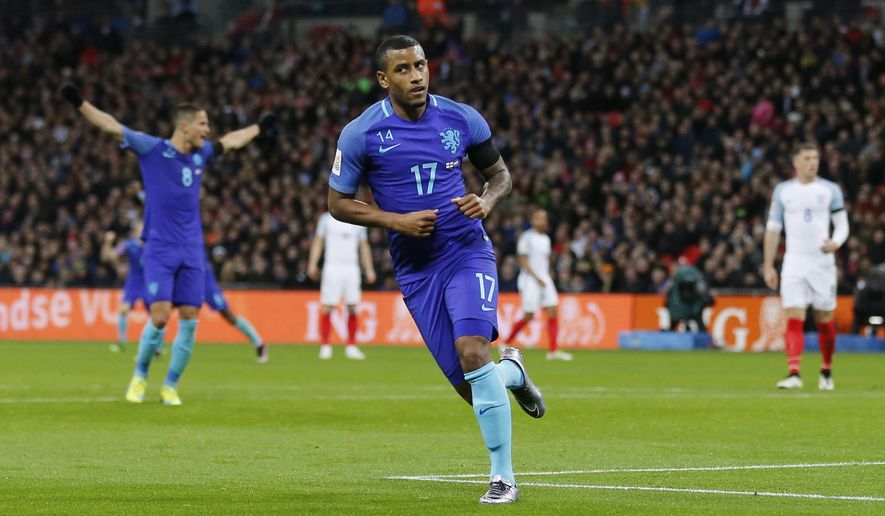 Netherlands' Luciano Narsingh celebrates scoring his side's second goal during the international friendly soccer match between The Netherlands and England at Wembley stadium in London, Tuesday, March 29, 2016. (AP Photo/Frank Augstein)