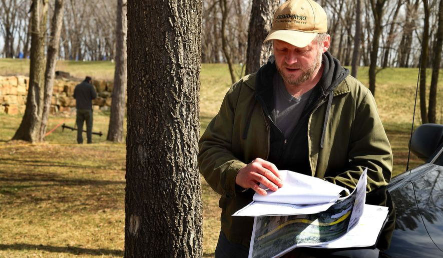 In this photo taken Monday, March 28, 2016, Geoffrey Jones looks at paperwork of an 1883 survey of the Rattlesnake Effigy site as he conducts ground -penetrating radar and electrical resistance testing at the site in Afton, Minn. Tribal representatives have asked Afton city officials to conduct more tests to ensure that the city's sewer construction activities will not impact possible burial sites that may be located at the area of the mound. Jones is an archaeological geophysicist and principal at Archaeo-Physics, LLC in Minneapolis. (Scott Takushi/Pioneer Press via AP)  MINNEAPOLIS STAR TRIBUNE OUT; MANDATORY CREDIT