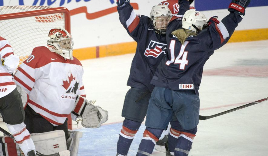 Team USA's Brianna Decker (14) celebrates with teammate Kendall Coyne (26) after scoring the second goal against Team Canada goaltender Emerance Maschmeyer during third period action at the women's world hockey championships Monday, March 28, 2016 in Kamloops, Canada. (Ryan Remiorz/The Canadian Press via AP)
