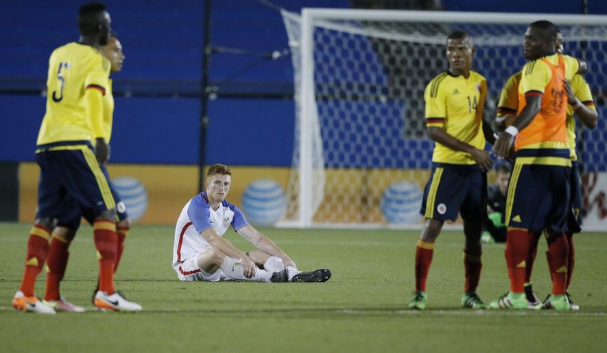 U.S. defender Tim Parker, center, watches as Colombia celebrates a 2-1 win in an Olympic qualifying soccer match Tuesday, March 29, 2016, in Frisco, Texas. (AP Photo/Brandon Wade)