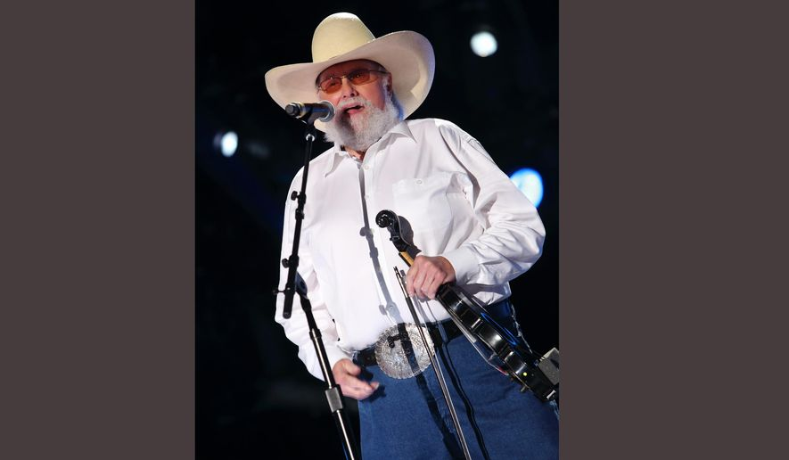 FILE - In this June 9, 2013 file photo, Charlie Daniels performs at LP Field on Sunday June 9, 2013 in Nashville Tenn. The Country Music Hall of Fame along with the Country Music Association, announced  Tuesday, March 29, 2016, it will induct fiddler Charlie Daniels, singer Randy Travis and producer and label owner Fred Foster into The Country Music Hall of Fame. (Photo by John Davisson/Invision/AP, File)