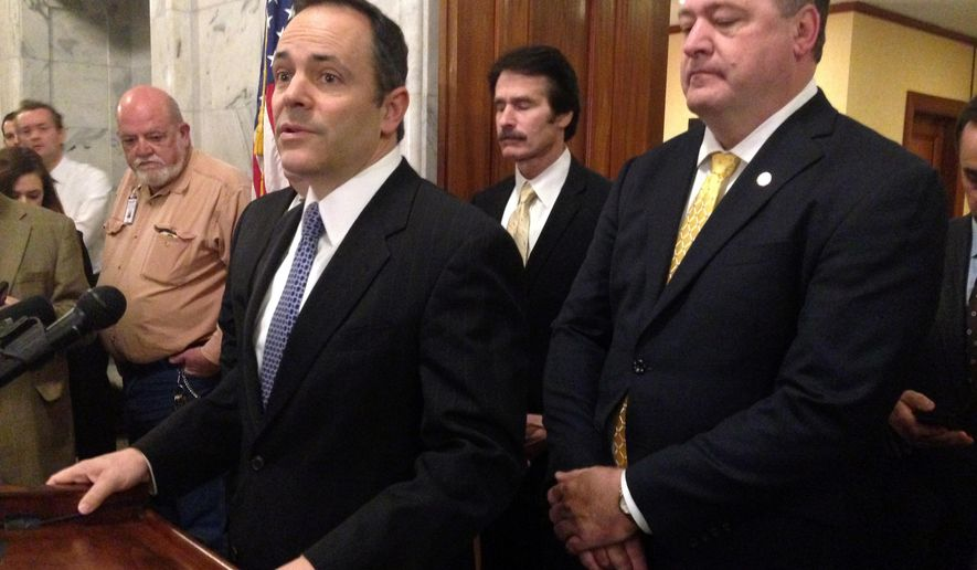 Republican Gov. Matt Bevin speaks with reporters about the status of Kentucky's budget negotiations as House Minority Whip Stan Lee and House Minority Floor Leader Jeff Hoover listen, on Tuesday, March 29, 2016 in Frankfort, Ky. (AP Photo/Adam Beam)