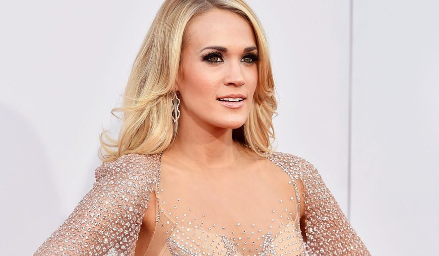 FILE - In this Nov. 22, 2015 file photo, Carrie Underwood arrives at the American Music Awards in Los Angeles. The Academy of Country Music asked Carrie Underwood to headline their Party for a Cause festival, the Grammy-winning singer said she wanted an all-female lineup to play with her. The Women of Country Night will feature performances by Underwood, Martina McBride, Kellie Pickler, Kelsea Ballerini, Maddie and Tae and Cam on the main stage and more new female artists on a side stage on Friday, April 1, 2016. (Photo by Jordan Strauss/Invision/AP, File)