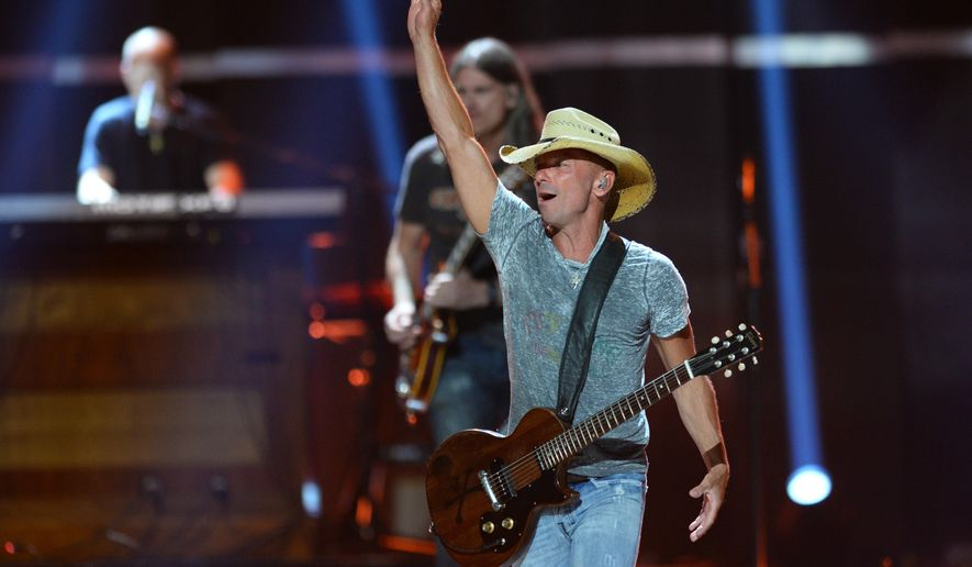 "FILE - In this Sept. 18, 2015 file photo, Kenny Chesney performs at Day 1 of the 2015 iHeartRadio Music Festival at the MGM Grand Garden Arena  in Las Vegas.  Chesney is getting his own ""No Shoes Radio"" channel on satellite radio's SiriusXM, seeking more exposure for an online venture he started in 2008 to share music with fans.  SiriusXM said Tuesday, March 29, 2016,  that the service will launch on April 12. (Photo by Al Powers/Powers Imagery/Invision/AP)"