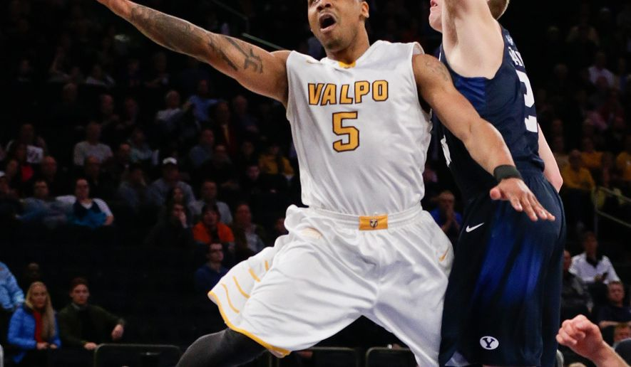 Valparaiso's Darien Walker (5) drives past BYU's Kyle Davis (21) during the first half of an NCAA college basketball game in the semifinals of the NIT on Tuesday, March 29, 2016, in New York. (AP Photo/Frank Franklin II)
