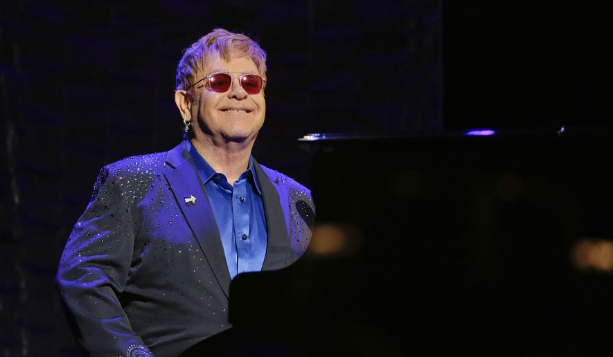 "Elton John appears during the ""Hillary Victory Fund I'm with Her"" benefit concert in New York on March 2, 2016. (Associated Press)"