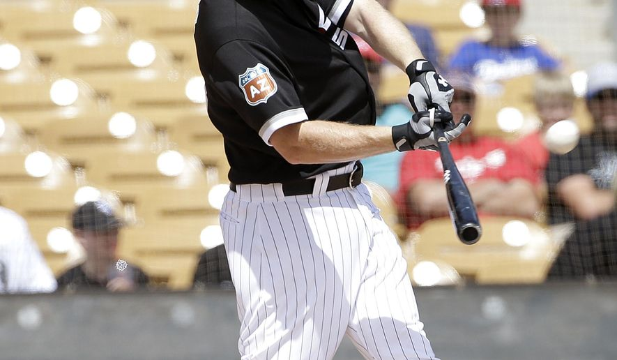 Chicago White Sox's Todd Frazier hits a two-run home run against the Texas Rangers during the first inning of a spring training baseball game in Glendale, Ariz., Tuesday, March 29, 2016. (AP Photo/Jeff Chiu)